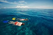 Two ladies snorkeling in the calm tropical sea