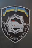 KIEV, UKRAINE - APR 30, 2014:Ukrainian Road Police chevron painted on the gate of Police Department