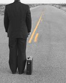 Businessman Standing In The Middle Of The Road