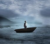 Composite image of businessman holding his jacket in a sailboat on open water