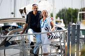Happy senior couple walking on a dock in summer