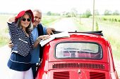 foto of ling  - Senior couple with vintage car lookinga t a map - JPG