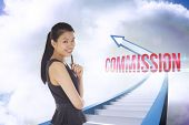 The word commission and thoughtful businesswoman against red staircase arrow pointing up against sky