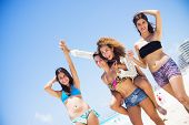 Group of friends having fun, walking at the paradise beach of Cancun