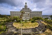 HACHIJOJIMA, JAPAN - MARCH 27, 2014: Exterior of the abandoned Oriental Resort Hotel. Though the island was once promoted as