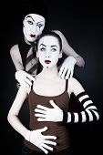 picture of mime  - mime man tempts woman on a black background - JPG
