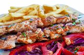 Постер, плакат: Meat Grilled On Skewers With Chips