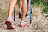 Close up of people walking along a hiking trail