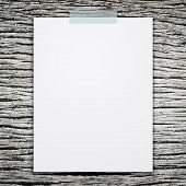 picture of memory stick  - Empty white paper sheet stick on wood texture background - JPG