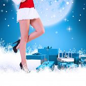 Festive womans legs in high heels against blue background with vignette