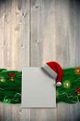 Fir branch christmas decoration garland against bleached wooden planks background