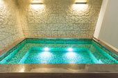 modern hotel spa interior, hot tub, stone wall