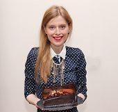 Holding Chocolate Cake