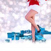 Festive womans legs in high heels against light glowing dots design pattern