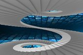 Winding stairs against walls of digital screens in blue