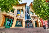 SOPOT, POLAND - 4 OCTOBER 2014: The Crooked house on the Heroes of Monte Cassino street in Sopot, Poland. The Crooked House is an irregularly-shaped, one of fifty strangest buildings of the world.
