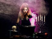 stock photo of dungeon  - Young and beautiful witch in a dungeon - JPG
