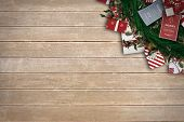 Festive christmas wreath with decorations against wooden surface with planks
