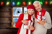 Happy festive couple with gifts against santa delivery presents to village