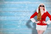 Cool santa girl wearing sunglasses against blurred wooden planks