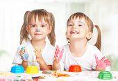 Happy Children Twins Draws Paints , Get Dirty