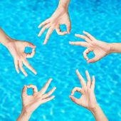 People's hands on water background