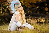 Fashion shot of a beautiful girl in style of the American Indians. Western style. Jeans fashion.