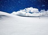 Background of cold winter landscape with snow, blue sky and sunlight