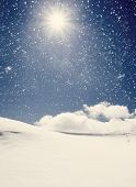 Vintage background of cold winter landscape with snow, blue sky and sunlight