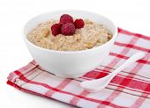 Tasty oatmeal with berries on napkin isolated on white