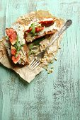 Tasty sandwiches with sweet figs and cottage cheese on wooden table