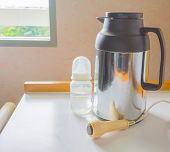foto of thermos  - still life image of Thermos call alarm and milk bottle - JPG