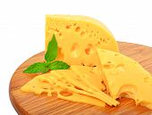 Cheese And Mint On The Wooden Board