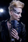Fashion Rocker Style Model Girl Portrait. Hairstyle. Punk Woman Makeup, Hairdo and black Nails. Smok