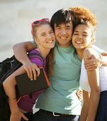image of school building  - cute group of teenages at the building of university with books huggings - JPG