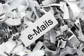 shredded paper tagged with e-mails, symbol photo for data destruction, mails and data flooding