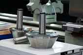 heads of a cnc milling machine in metal industry