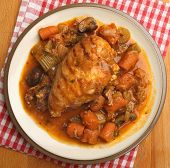 Chicken breast casseroled with carrots, celery and mushrooms.