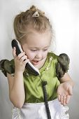 Little Girl Speaks On The Telephone.