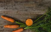 Delicious carrots on a wooden table