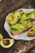 Delicious avocado sandwich on a wooden table