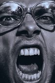 Monochrome Angry Man In Old Glasses