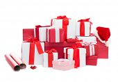 holidays, winter, birthday and celebration concept - christmas presents, decoration paper and santa helper hat