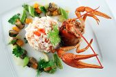 stock photo of cooked blue crab  - Risotto with crab and vegetables sauce on white plate - JPG