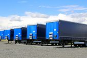 Row Of Blue Trailers On A Yard