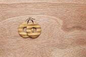 Wooden Earrings On Wooden Background