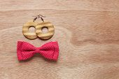 Wooden Earrings And Red Bow Tie