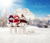 Winter holiday happy snow men with blur landscape on background. Concept love and togetherness