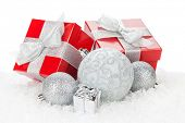 Christmas baubles and red gift boxes. Isolated on white background