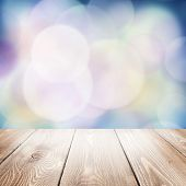 Autumn nature background with wooden table and blurred bokeh
